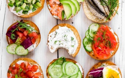 Selection of colourful open sandwiches arranged on a table - Plus Pack