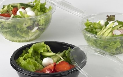 round bowls of with salad in clear and black material with clear lids - Plus Pack